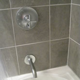This bathroom remodel required tile, fixture, and tub install work.